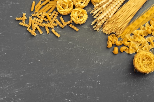 Various pasta top view background. cooking concept