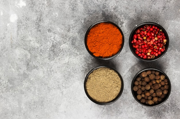 Various pepper on a gray background. top view, copy space. food background