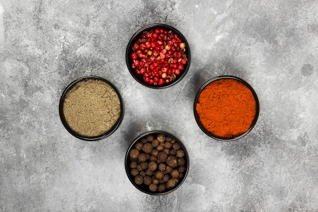 Various pepper on a gray background. top view. food background
