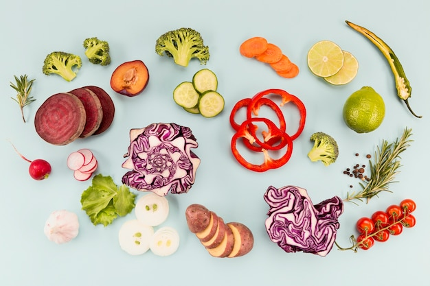 Various piles of cut veggies and tomatoes