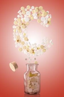 Из стеклянной банки вылетают различные таблетки в виде буквы c