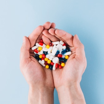Various pills in hand