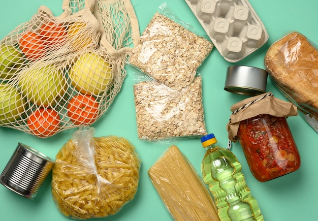 Various products, bread, pasta, sunflower oil in a plastic bottle and preservation, top view