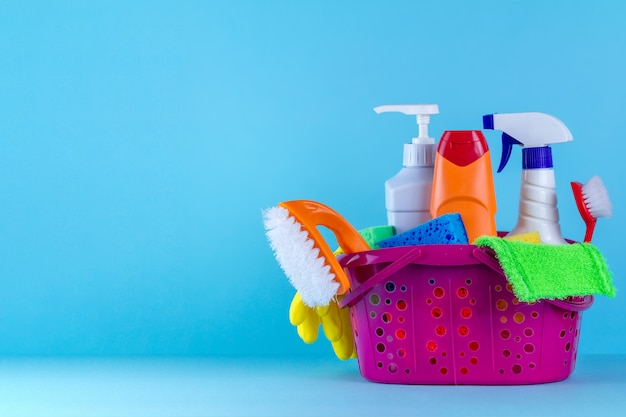 Various products for cleaning the house in a basket