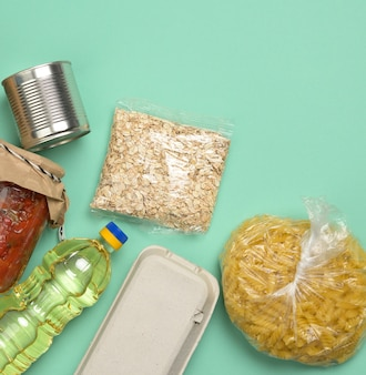 Various products, pasta, sunflower oil in a plastic bottle and preservation, top view