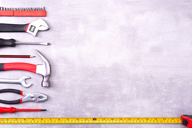 Various repair tools on a gray background. equipment for construction. repair tool kit. top view template copy space
