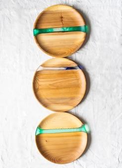 Различные круглые деревянные подносы для рукоделия со вставками из смолы