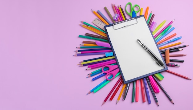 Various  school supplies  on a bright pink background