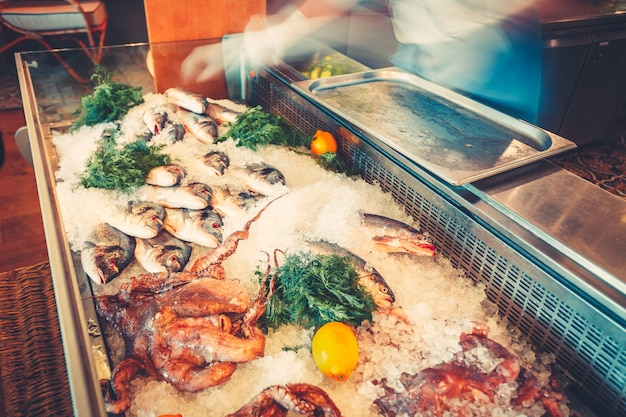 Various seafood on the shelves of the fish market