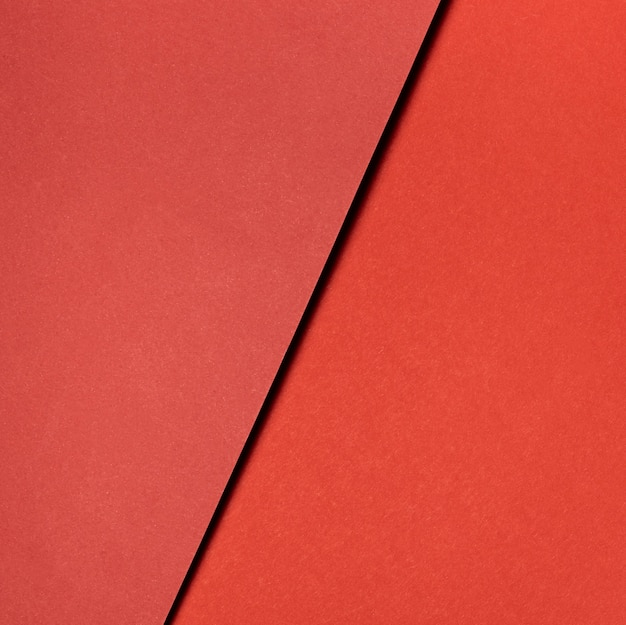 Various shades of red paper close-up