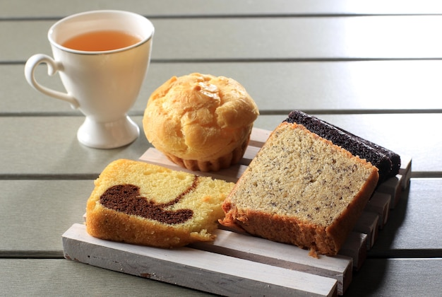 Various slice cake for snack box. banana cake, marble cake, and black sticky rice cake. served with tea