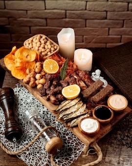 Various snacks on wooden desk