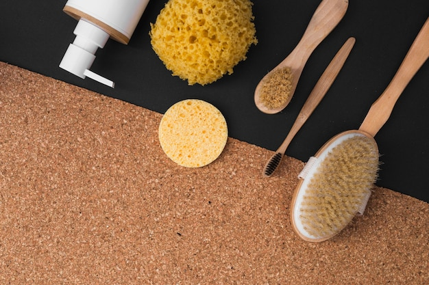 Various spa products on black and cork background