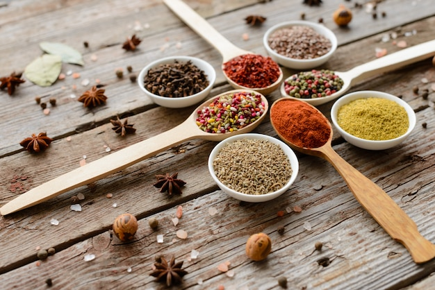 Various spices against a dark background. food ingredients. it can be used as a background