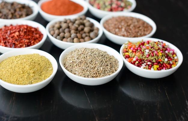 Various spices against a dark background. food ingredients