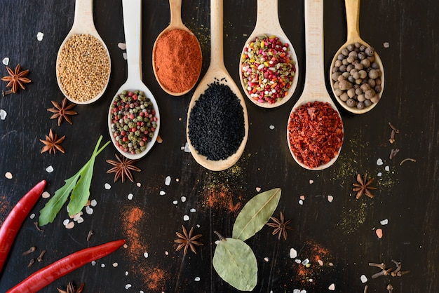 Various spices against a dark background. food ingredients
