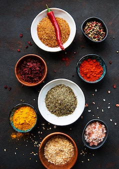 Various spices on a black background