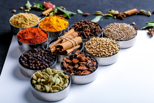 Various spices in a bowls on white. top view with copy space.