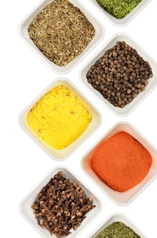Various spices and herbs isolated on white background