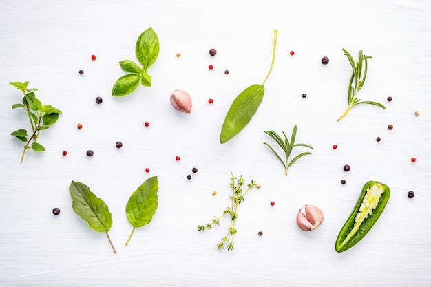 Various of spices and herbs on wooden background.