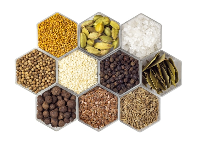 Various spices in hexagonal jars isolated
