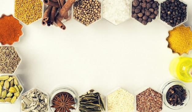 Various spices in hexagonal jars