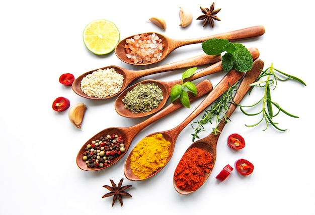 Various spices isolated on white table, top view