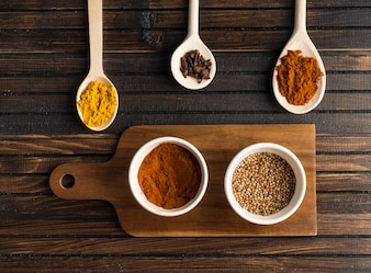 Various spices near cutting board