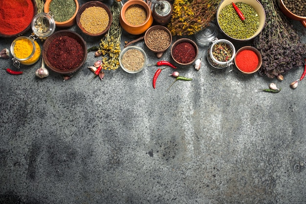 Various spicy spices and herbs. on a rustic background.