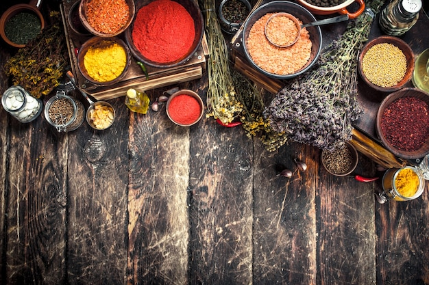 Various spicy spices and herbs. on a wooden background.