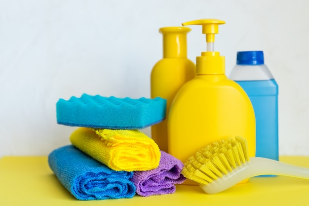 Various sponge and plastic bottles with cleaning products
