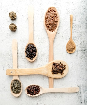 Various spoons with arrangement of seeds