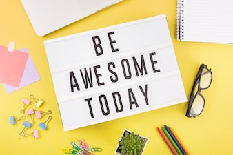 Various stationeries with be awesome today text on yellow background