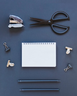 Various stationery on dark blue table