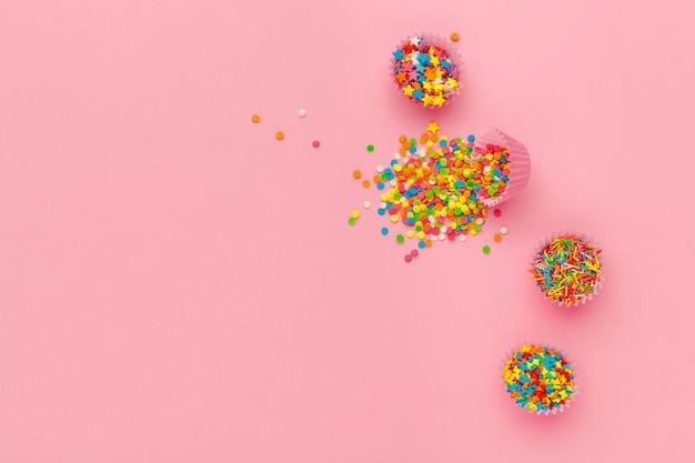 Various sugar sprinkles, food background with copy space
