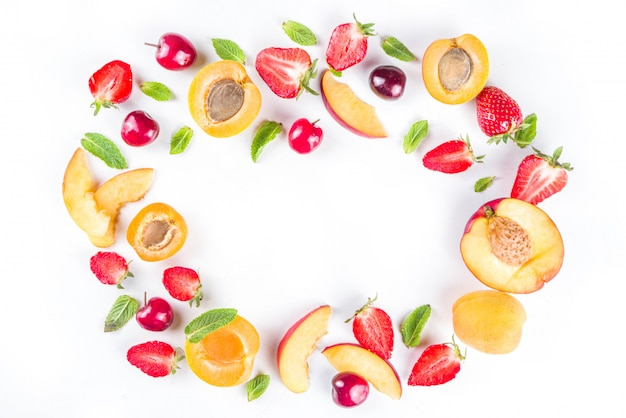 Various summer fruit and berries on white, flatlay pattern