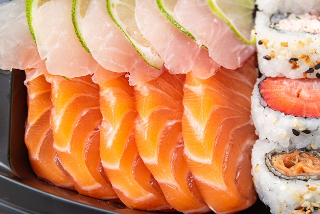 Various sushi on the plate on the table - detail