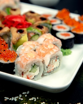 Various sushi rolls on plate