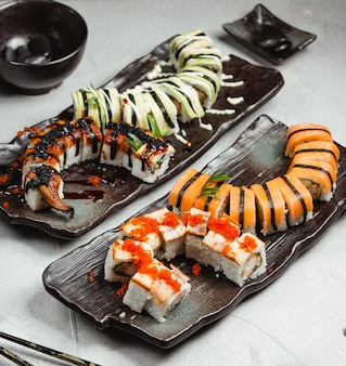 Various sushi sets on the table