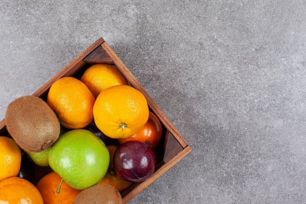 Various sweet fresh fruits on a wooden basket