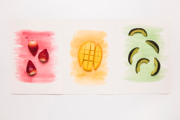 Various tasty fruits on multicolored watercolor splash