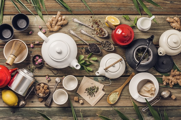 Various tea and teapots composition, dried herbal, tea and matcha tea on wooden table