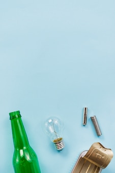 Various tips of recyclable garbage on light blue background