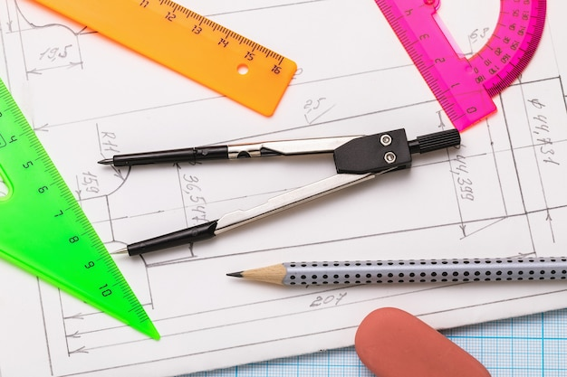 Various tools for sketching on paper with blueprints