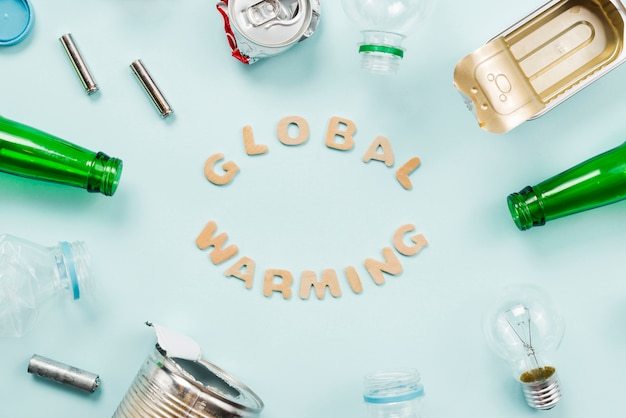 Various trash around global warming lettering