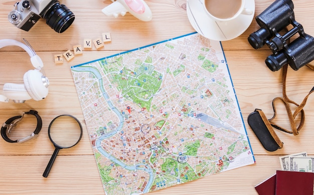 Various traveler accessories on wooden surface