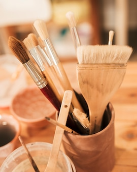 Various type of paint brushes in the clay holder