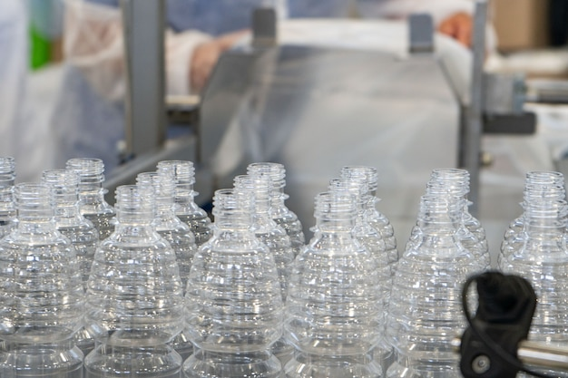 The various type of plastic bottle product and preform material with injection mold background drinking container manufacturing processing