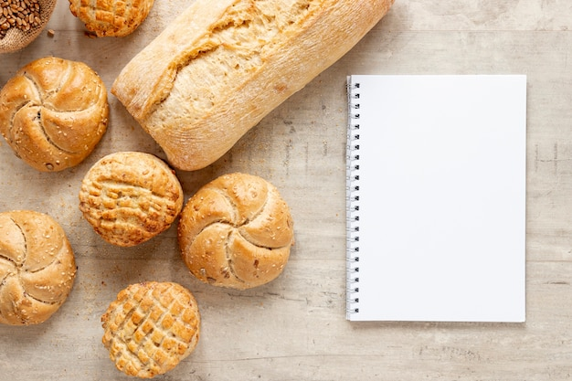 Various types of bread and a notebook