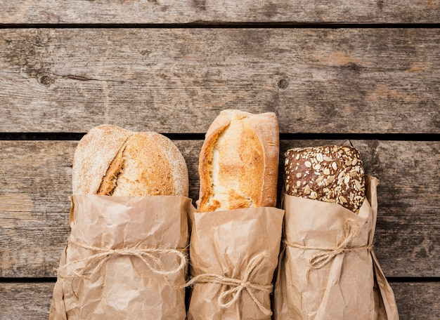 Various types of bread wrapped in paper